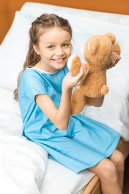 Little patient with teddy bear