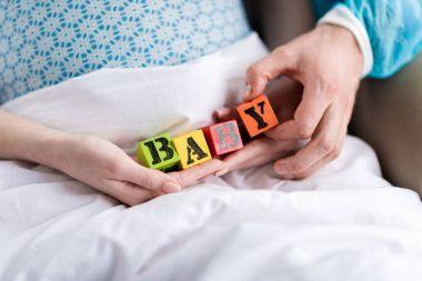 Pregnant woman with baby cubes