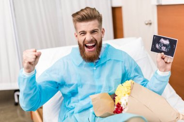happy man with sonogram