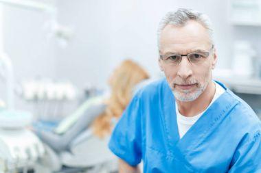 senior dentist in uniform