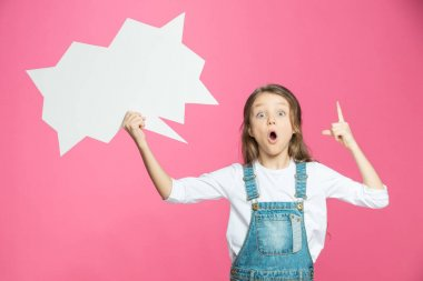 Adorable little girl holding blank speech bubble and pointing up with finger isolated on pink stock vector