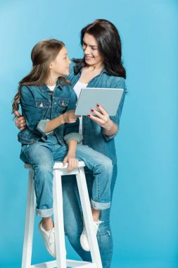 mother and daughter with digital tablet