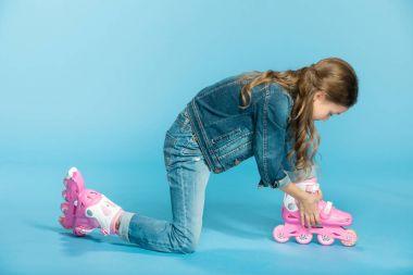 girl in pink roller skates