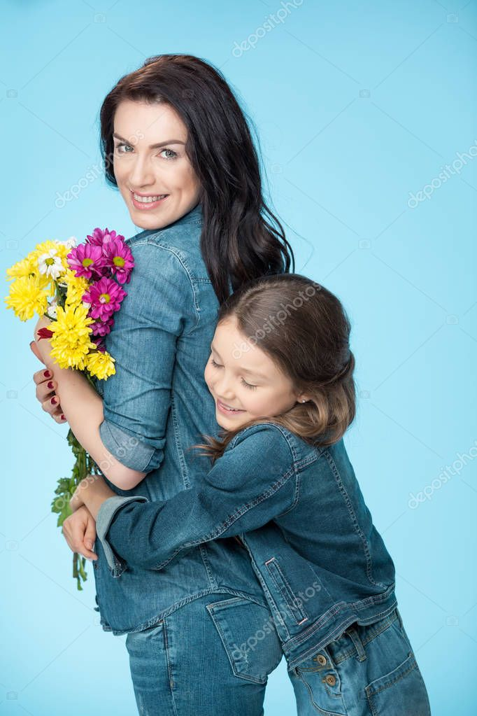 Mother and daughter holding flowers
