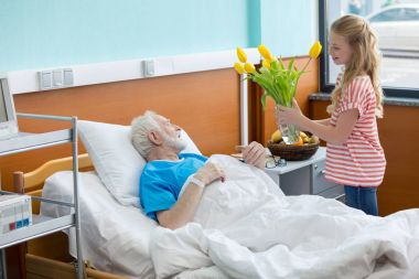 senior patient with granddaughter