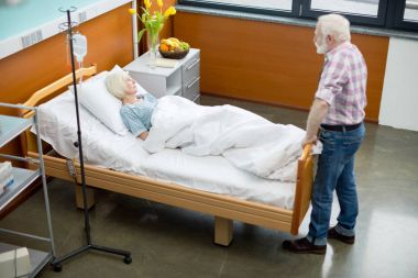 Senior man and woman in hospital