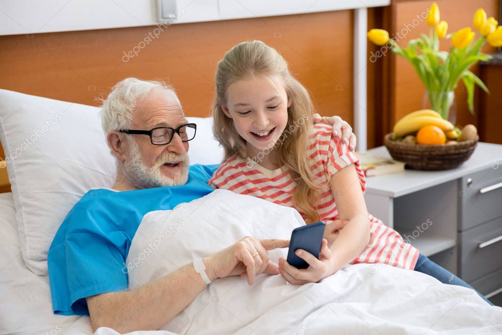 grandfather and child using smartphone