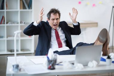 Mature businessman at workplace