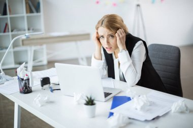 Stressed businesswoman at workplace