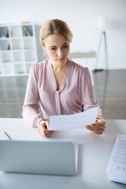Serious businesswoman working with documents
