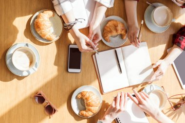 women sitting at coffee break