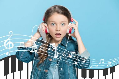 Adorable little girl in headphones