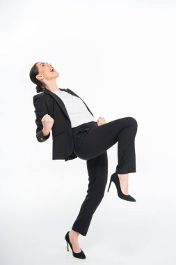 Cheerful businesswoman triumphing