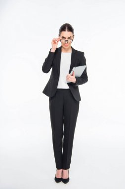 Attractive businesswoman holding digital tablet and eyeglasses isolated on white stock vector
