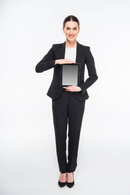 Businesswoman holding digital tablet and smiling at camera isolated on white stock vector