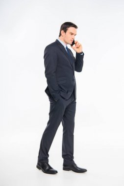 Businessman talking on smartphone
