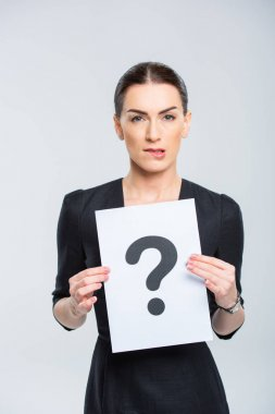 Woman holding card with question mark