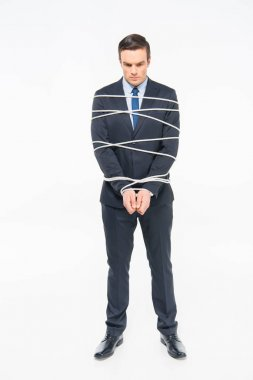 Sad young roped businessman isolated on white stock vector