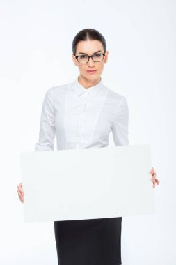 Businesswoman with blank card