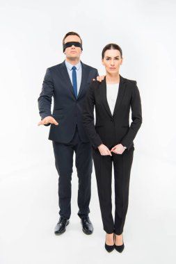 Businessman in blindfold and businesswoman