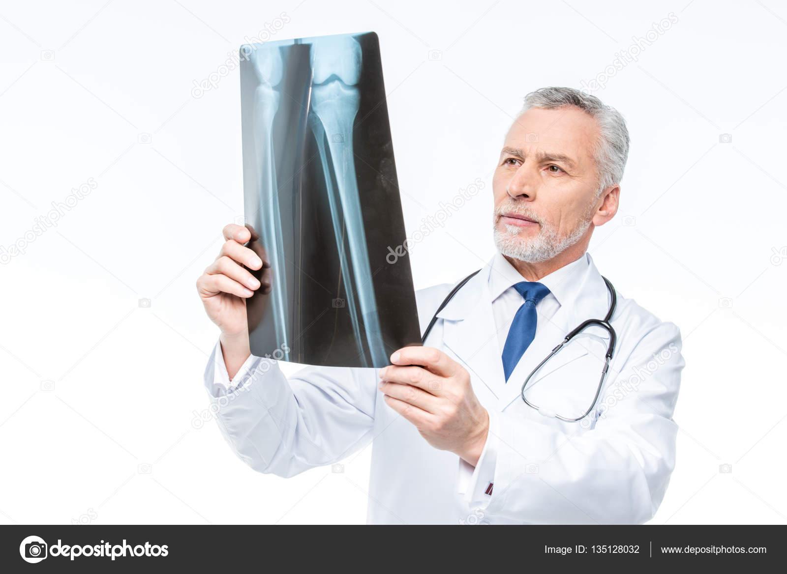 doctor looking at x-ray — stock photo © igortishenko #135128032
