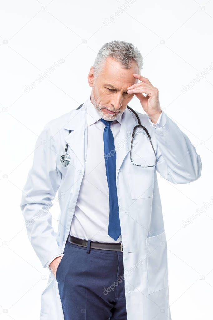 Mature doctor with stethoscope