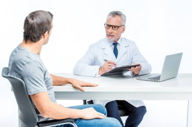 Mature doctor with patient