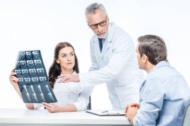 Doctors examining x-ray image