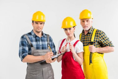 Group of professional male and female construction workers looking at camera  isolated on white stock vector