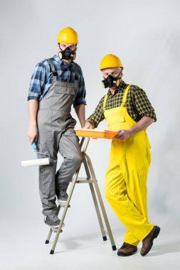 Workmen with paint roller