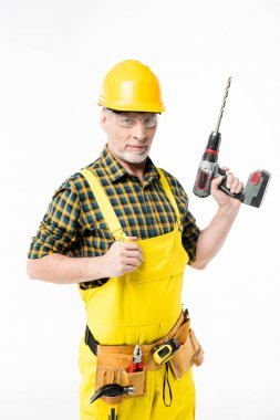 Workman holding electric drill