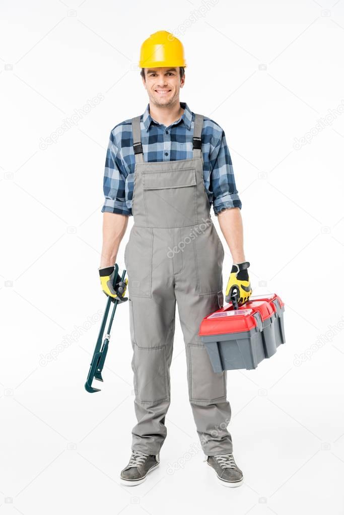 Workman holding tool kit