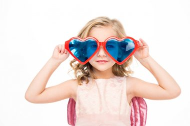 Girl in heart shaped glasses