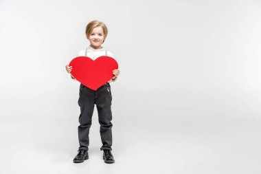 Boy with red paper heart