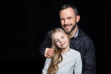 Smiling father and daughter