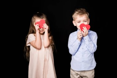 Adorable little kids holding red paper hearts  isolated on black stock vector