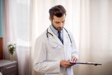 Doctor holding folder