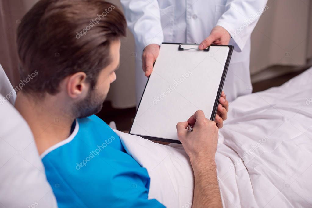 Patient signing medical document