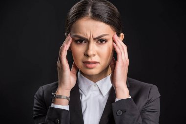 Young businesswoman with headache