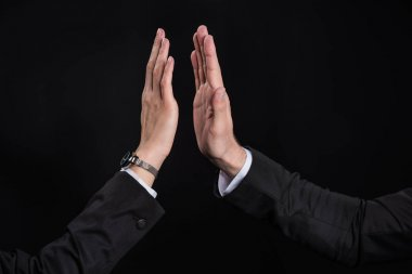 Businesspeople giving high five