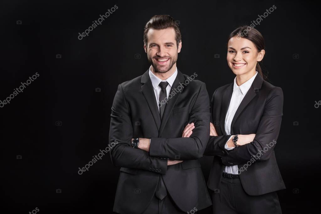 Young smiling businesspeople
