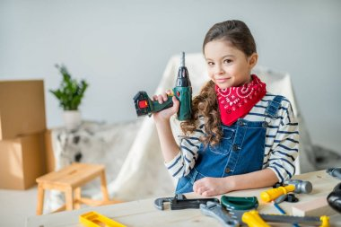 Little girl with tools