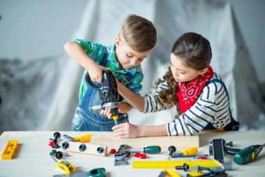 Boy and girl with tools