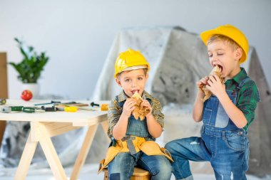 Boys eating sandwiches