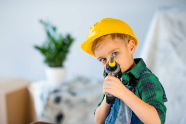Little boy with toy drill