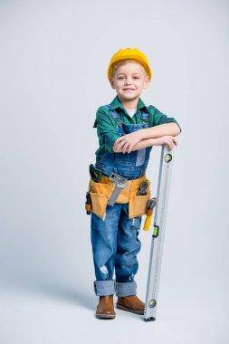 Little boy in tool belt