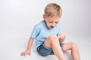 Little boy with patch on knee