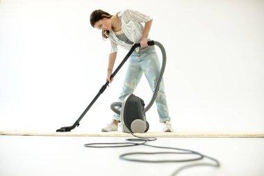 Woman vacuuming carpet