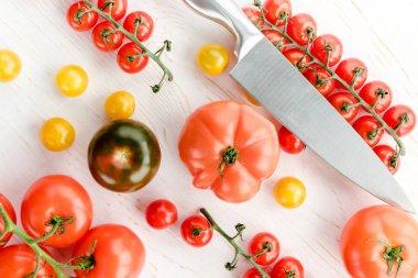 Fresh tomatoes and knife
