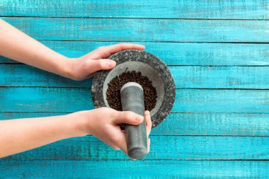 mortar and pestle in hands